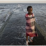Young girl by Indian Ocean, Maputo, Mozambique