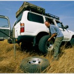 Driver Repairs Flat Tire on Safari, Masai Mara Game Reserve, Kenya, Africa