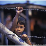 Young Boy at Barbed Wire Fence, Bacolod, Negros Island, Philippines