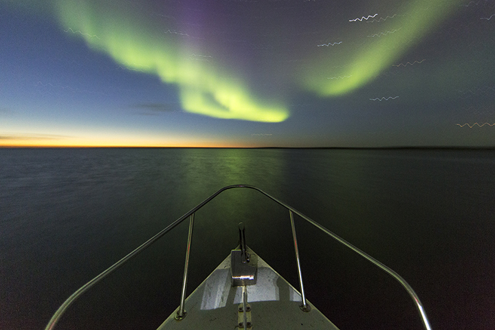 Northern Lights above Expedition Boat, Nunavut, Canada
